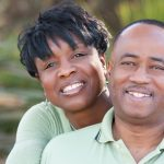 Attractive and affectionate african american couple posing in the park